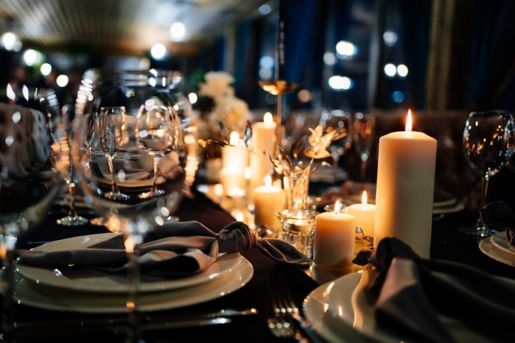 Wedding traditions being carried out, a dinner table with plates and candles