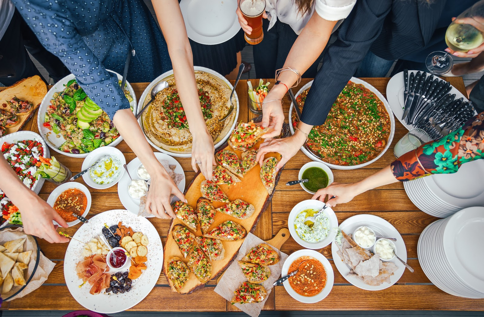 Friends Happiness Enjoying Dinning Eating Concept. Food Buffet. Catering Dining. Eating Party. Sharing Concept. close-up